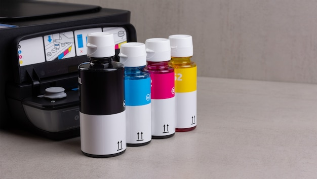 Inkjet four-color printer with continuous ink supply and ink bottles