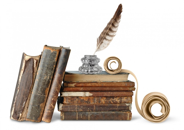 Inkstand and scroll over a pile of antique books over white wall