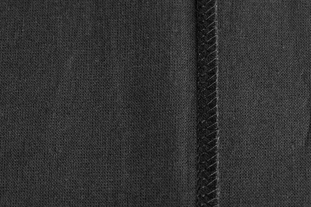 Внутренний шов на черной льняной ткани в качестве фона
