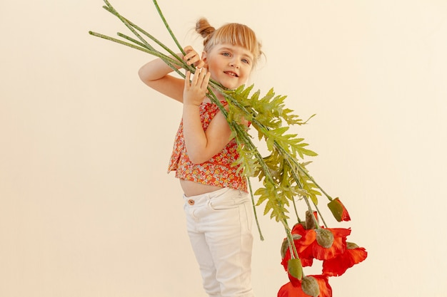 Innocent toddler holding flowers
