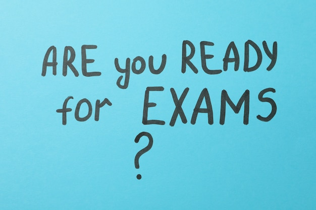 Inscription are you ready for exams on blue surface, top view