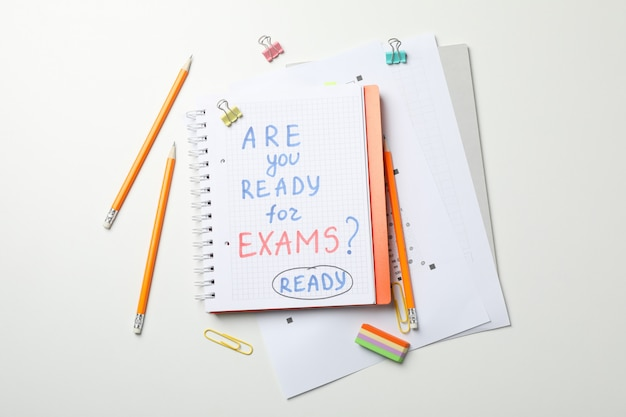 Inscription are you ready for exams? ready and stationary on white, top view