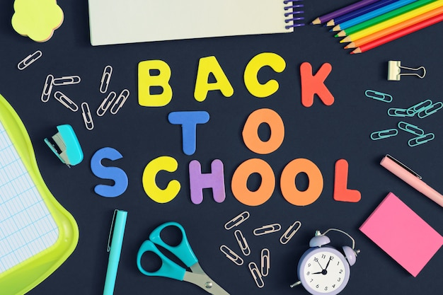 The inscription back to school is made in colored letters.