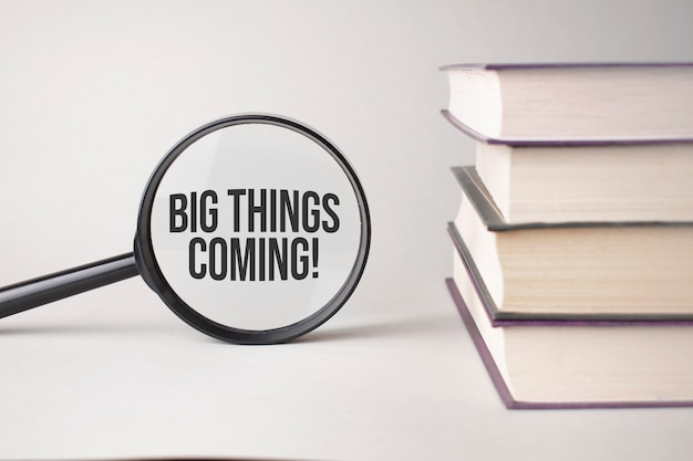 The inscription big things coming is written and the books. content lettering is essential for business content and marketing.