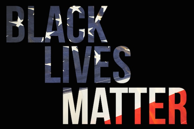 The inscription black lives matter in the background of the american flag