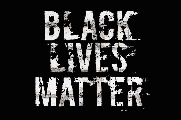 The inscription black lives matter on the brick wall