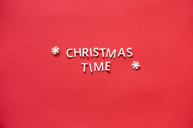 Inscription christmas time from letters on a red background