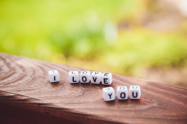 The inscription of the cubes i love you on a wooden table