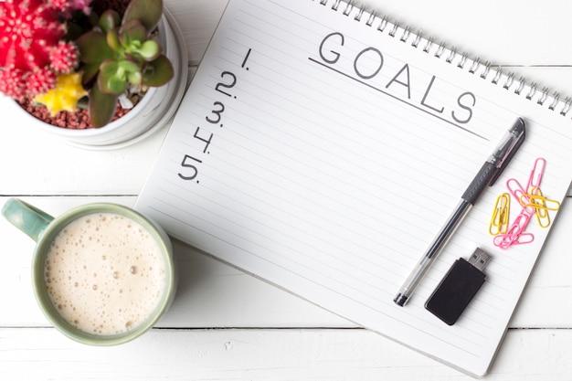 Inscription goals in a notebook