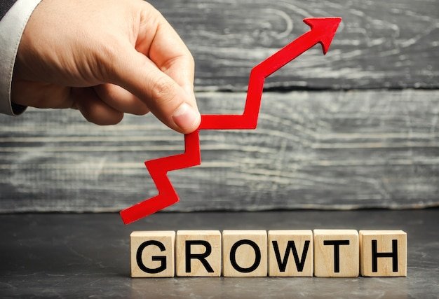 The inscription growth and up arrow. the concept of a successful business. increase in income