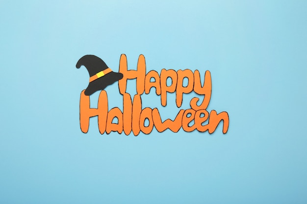 Inscription happy halloween on blue background. top view
