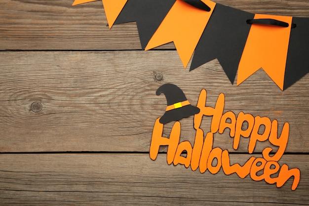 Inscription happy halloween on grey wooden background