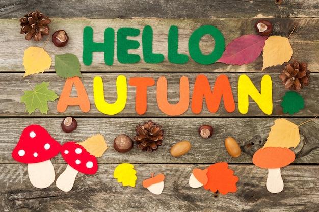 Inscription hello autumn, leaves, mushrooms, acorns made of felt