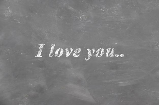 Inscription i love you on the chalk school blackboard children's drawing