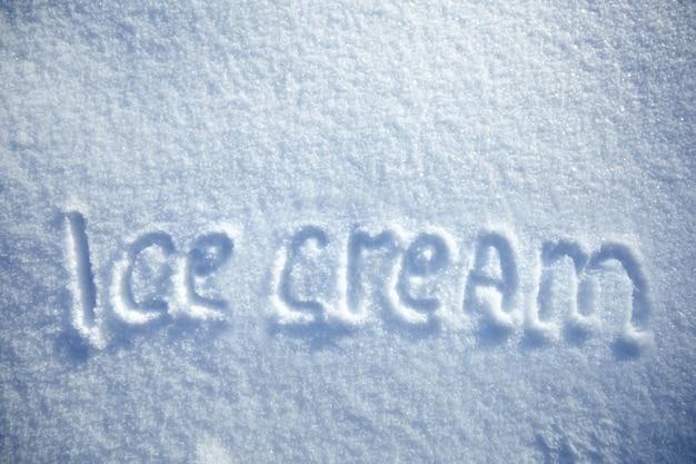 Inscription ice cream on snowy background