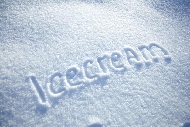 Inscription ice cream on snowy winter background