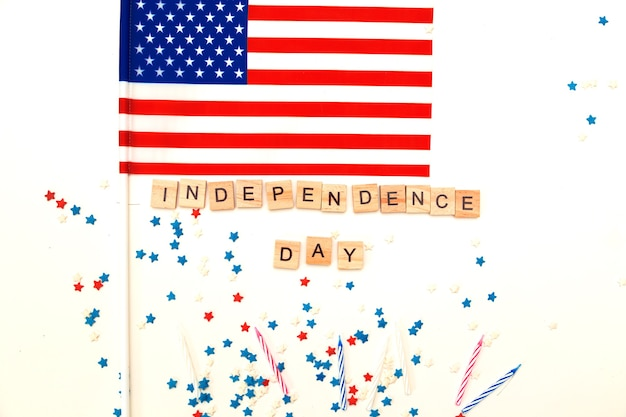 The inscription independence day in wooden letters on a white background. for independence day on july 4 (memorial day).