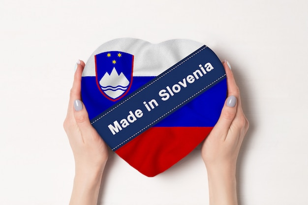 Inscription made in slovenia flag with heart shape box