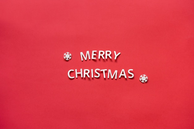 Inscription merry christmas from letters on a red background