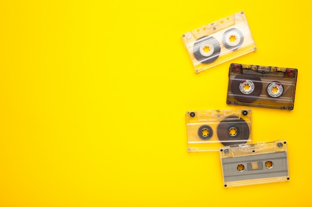 Inscription music day with old cassettes on a yellow background. music day