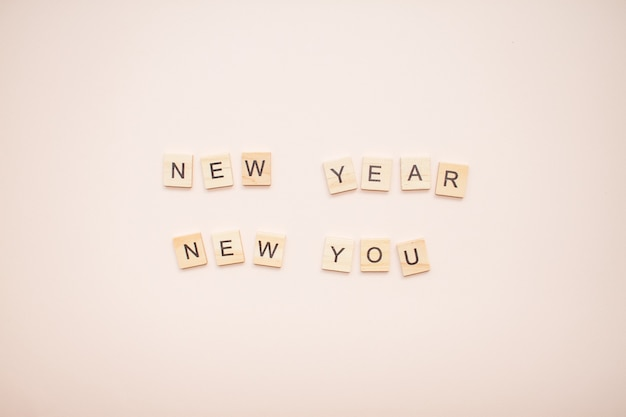 The inscription new year new you from wooden blocks