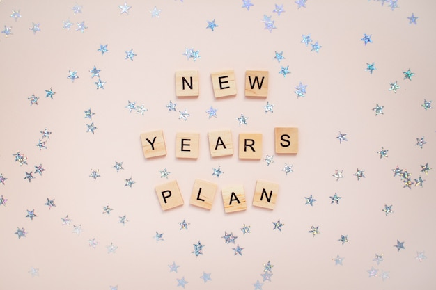 The inscription new years plan from wooden blocks with silver stars