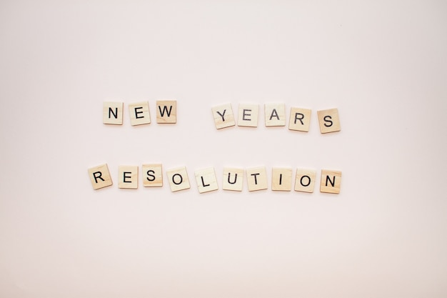 The inscription new years resolution from wooden blocks
