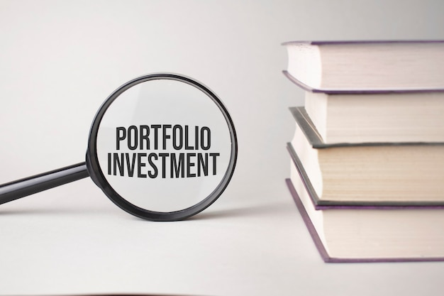 The inscription portfolio investment is written and the books. content lettering is essential for business content and marketing.
