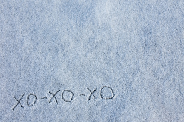 Inscription on snow is hohoho in ukrainian merry christmas and happy new year greeting card