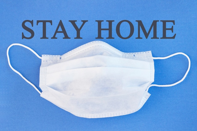 Inscription stay home. medical face shield. coronavirus, pandemic, stay home, stay safe