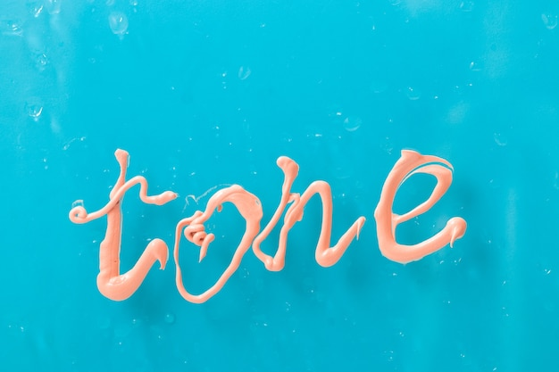 Inscription tone from foundation on glass blue background