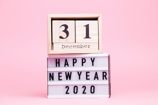 Inscription on a white box with backlight with calendar of cubes with the inscription december 31