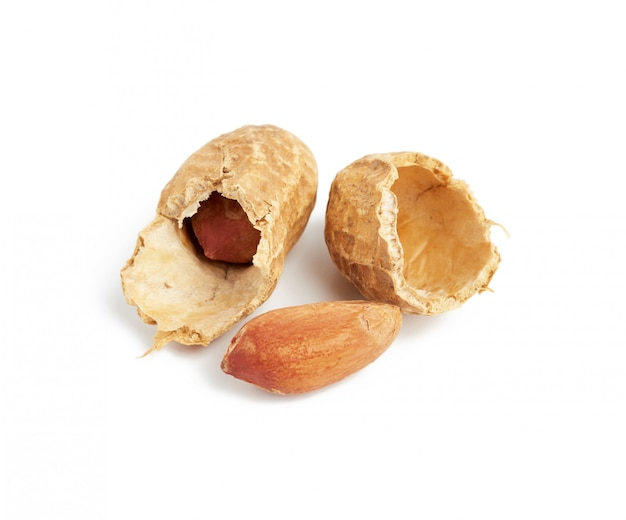 Inshell peanuts broken in half, food isolated on white space