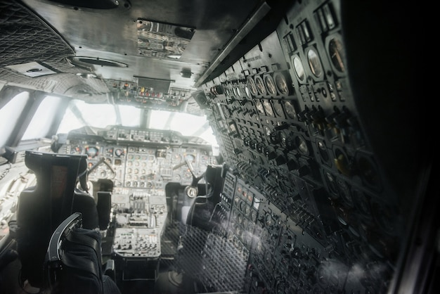 Inside of the aged plane with two pilot seats and instruments Premium Photo