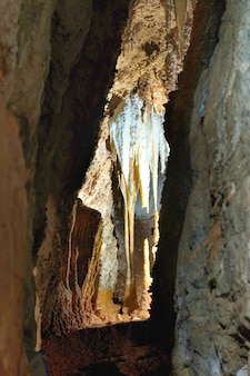 Inside of beautiful old dark cave with many stalactites. grotte di is zuddas, italy, sardinia