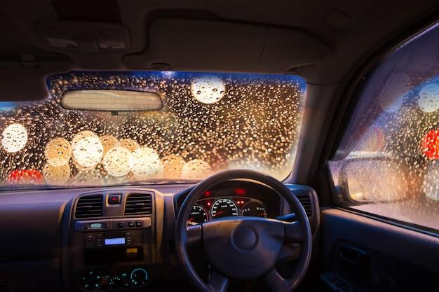 Inside car with bokeh lights from traffic jam