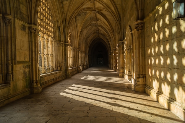 Inside the cloister of catholic monastery of batalha in portugal.