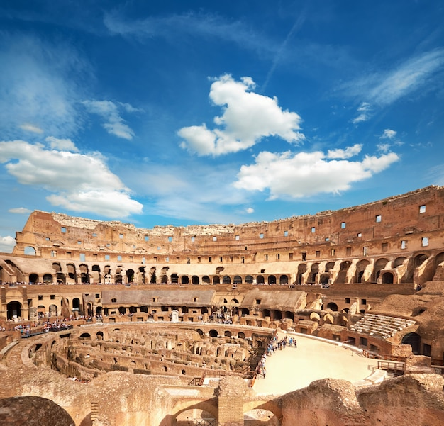 Inside of colosseum rome with blue white sky, rome, italy