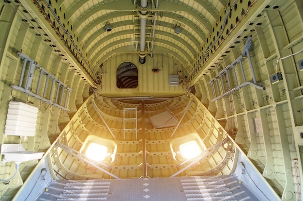 Inside the compartment of a large cargo helicopter.