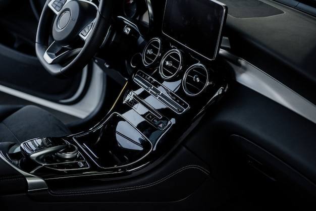Inside of the modern car. steering wheel and front instruments.