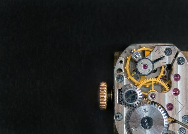 Inside of old vintage clock pocket watch on black surface
