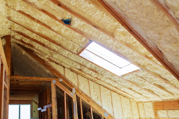 Inside wall insulation in wooden house, building under construction