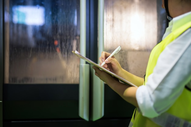 Inspector writing note in factory