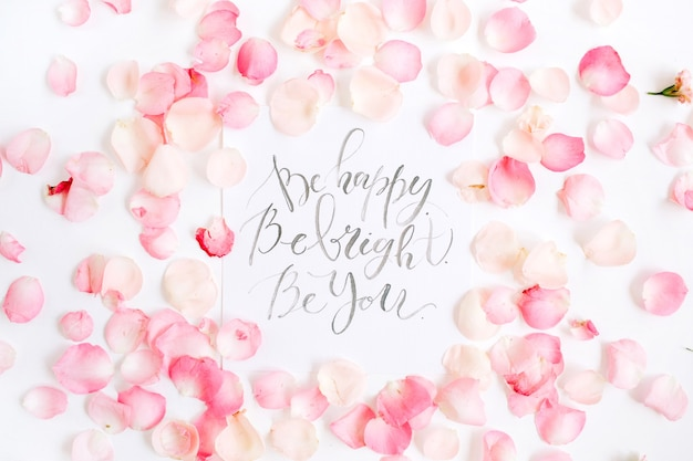 Inspirational quote made with calligraphy and floral pink rose petals