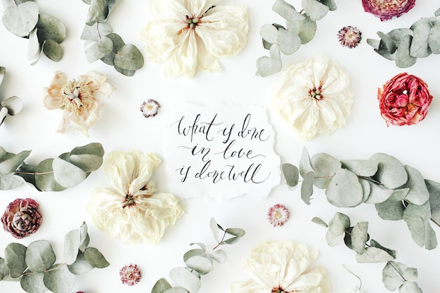 Inspirational quote written in calligraphic style and leaves