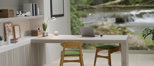Inspirational workspace in modern living room laptop computer blurred natural waterfall view