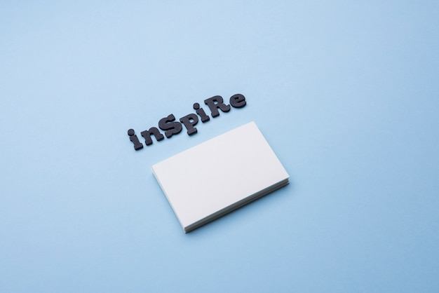 Inspire word and pile of business cards