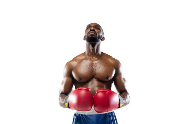 Inspired. funny, bright emotions of professional african-american boxer isolated on white  wall. excitement in game, human emotions, facial expression and passion with sport concept.