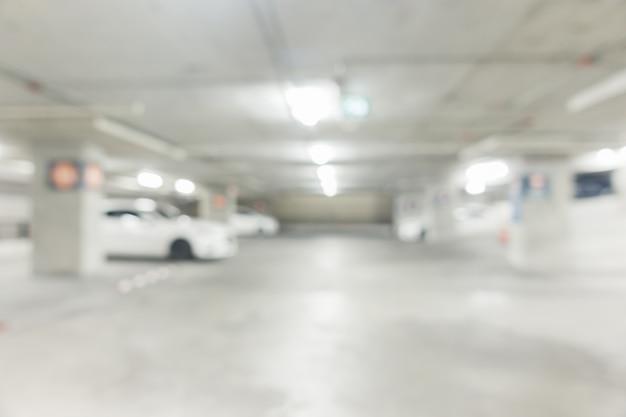 背景、車のための抽象的なぼかし駐車場。レトロなinstagramスタイルのフィルターを使って地下駐車場をぼかす。