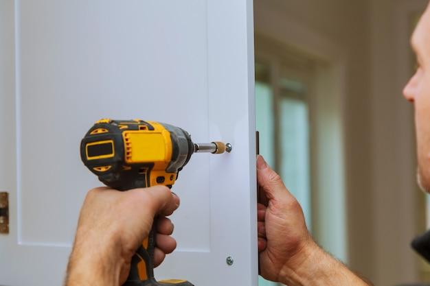 Installation of door handles on kitchen cabinets